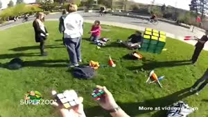 Solving Three Rubik Cubes While Juggling