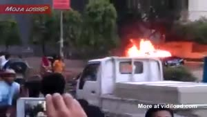 People Watch Car On Fire