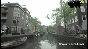 BMX'er Jumps Canal In Amsterdam