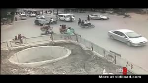 Biker Fall Into Huge Hole In The Ground