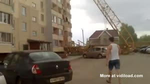 Crane Falls Through Building