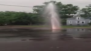 Heavy Rain Turns Pothole Into Geyser