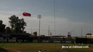 Skydiver Lands On Baseball Field