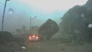 Giant Rock Almost Crushes Car