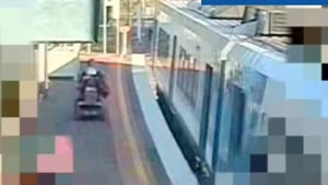 Mobility Scooter Tries To Board Train