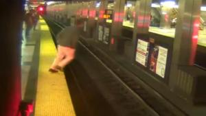Man Faceplants On Train Tracks