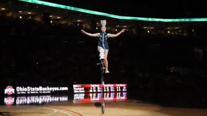 Unicyclist Flips Bowls On Her Head