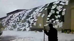 Snow Falls Off Roof In Texas