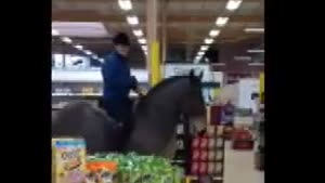 Girl Rides Horse In Supermarket