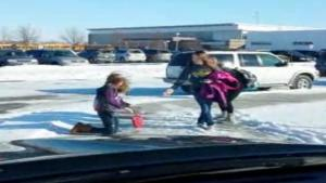 Dad Laughs At Kids Falling On Ice