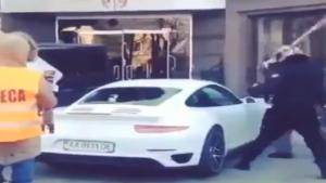 Protesters Destroy Politician's Porsche