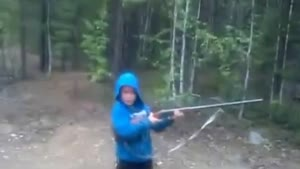 Guy Lets Son Shoot A Rifle