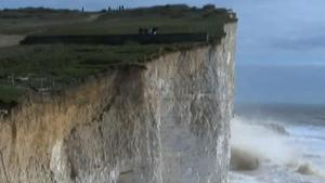 Part Of Cliff Breaks Off Near Oblivious People