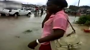 Lady Falls In Pothole
