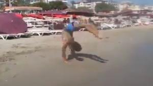 Bizarre Back Flips On The Beach
