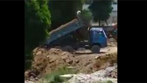 Truck Almost Vanishes In Sinkhole