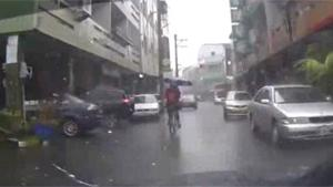 Cycling With An Umbrella Ends In Crash