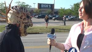 Masked Man Surprises TV Reporter