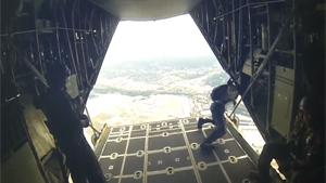 US Navy Paratroopers Jump From Plane