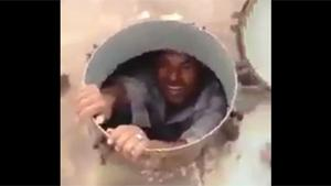 Afghan Guy Rescued From Water Tank