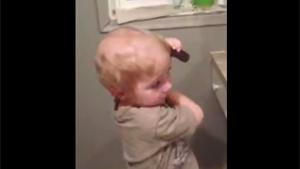Kid 'Combing' His Hair