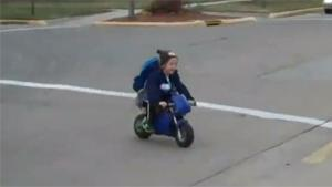 Kid Rides Mini Motorbike To Kindergarten