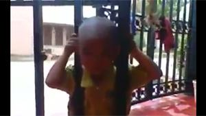 Kid Has Head Stuck In Gate