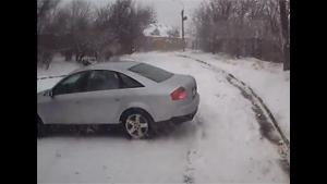 Car Curling On Icy Slope