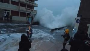 Wave Takes Out Weather Forecaster