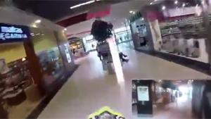 Motorist Racing Through Shopping Mall