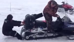 Russian Sucked Into Snow Scooter