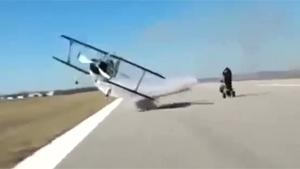 Biplane Makes Insane Low Flyby