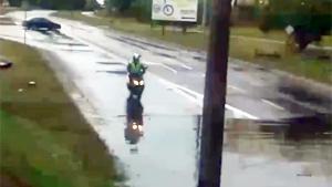 Scooter Vs Flooded Road