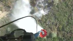 Dropping Water On Forest Fire