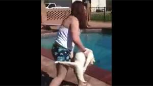 Girl Throws Cat In Pool