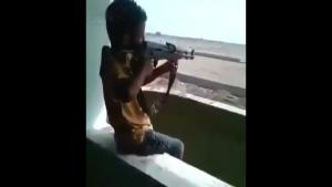 Kid Playing With AK-47