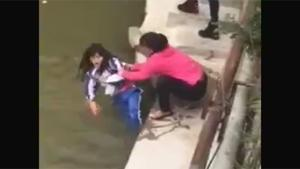 Chinese Mom Threatens To Drown Daughter