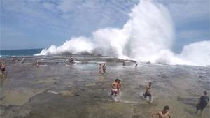 Big Wave Takes Out Everyone