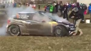 Rally Car Runs Over Photographer