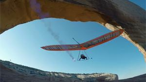 With Hang Glider Through Narrow Arch