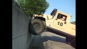 Hummer Driving On Vertical Wall