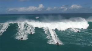 Waterscooters Outrunning Big Wave