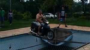 Motorcycle Stunt Ends Wet