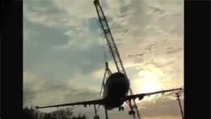 Crane Collapses With Plane