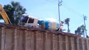 Cement Mixer Falls From Ramp