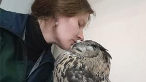 Woman Cuddling Her Eagle Owl