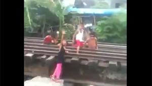 Kids Playing On Railroad Track