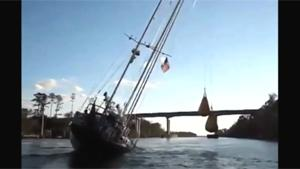 Inventive Sailor Sails Under Low Bridge
