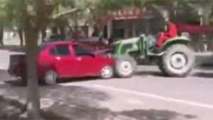 Angry Farmer Takes It Out On Car