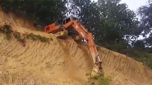 Excavator Takes The Short Way Down